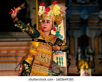 Bali, Indonesia - May 21, 2019: Balinese dancer performing classical Legong dance wearing traditional costumes at Pura Saraswati temple in Ubud, Bali, Indonesia.