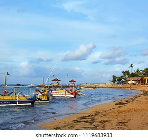 Bali, Indonesia - May 29, 2018; Colorful Balinese outrigger style wooden fishing boats on the shore at Sanur, Bali, Indonesia.