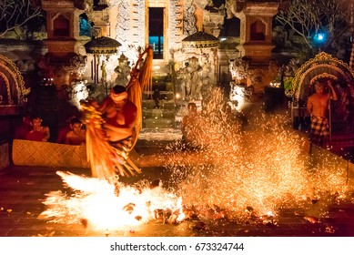 Bali, Indonesia - May 3, 2017 : Popular Kecak Fire and Trance Dance with a fragment from the Hindu epic Ramayana story presented by Taman Kaja Community at Pura Dalem Taman Kaja, Ubud, Bali, Indonesia
