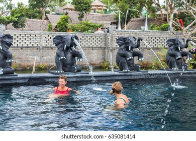 BALI, INDONESIA - MAY 5, 2017: Two Healthy senior women swimming in the nature swimming pool. Active lifestyle. Bali island. Thermae of Bali.