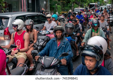 BALI, INDONESIA - NOVEMBER 12, 2016: Scooter drivers crowd the road of Ubud town on Bali