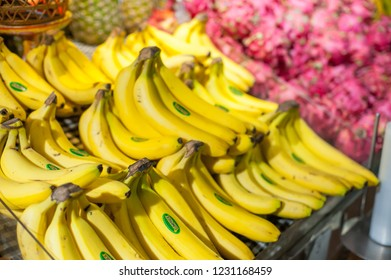 BALI, INDONESIA - November 12, 2018 -variety of Bali fruits like  Pineapple, banana, Dragon fruits have display and sell at local supermarket in Bali, Indonesia. Selective focus and blur background.