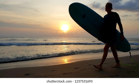 Bali, Indonesia - November 15, 2018 : surfer in Batu Bolong Beach Canggu