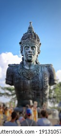 BALI, INDONESIA - November, 23th, 2018. one of the statues in the Garuda Wisnu Kencana Cultural Park, some tourists are watching a show in front of the statue, Bali, Indonesia