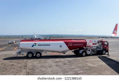 Bali, Indonesia - November 3, 2014: Pertamina Tanker Truck in I Gusti Ngurah Rai Airport Apron