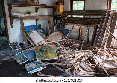 BALI, INDONESIA - NOVEMBER 6, 2016: Abandoned workshop with broken frames of the pictures in Ubud, Bali, Indonesia