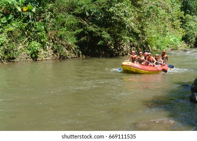 Bali Indonesia - Oct 20, 2015.Group of adventurer doing white water rafting activity at Ayung River Ubud Bali on Oct 20, 2015.The river is popular for its adventure and scenic nature view.