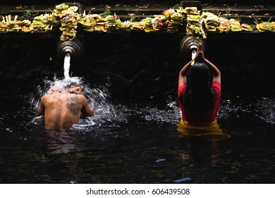 BALI, INDONESIA - OCTOBER 1, 2016: Tirta Empul Holy Water Temple is a public place where people can come to pray and cleanse themselves. It is a famous Hindu temple in Bali, Indonesia