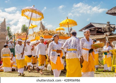 BALI, INDONESIA - OCTOBER 13, 2015: Unidentified people celebrate their ceremony during the day time at the temple.