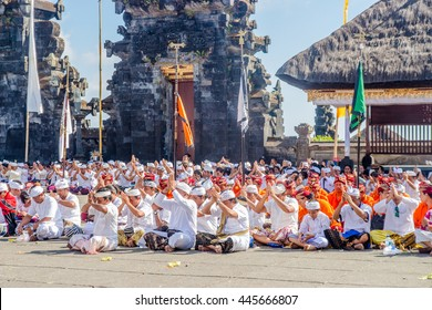 BALI, INDONESIA - OCTOBER 13, 2015: Unidentified people praying in the temple in Pura Besakih temple