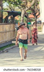 BALI, INDONESIA - OCTOBER 13, 2017: Man walking in the park of Bali island, Indonesia. Street photography, lifestyle,.