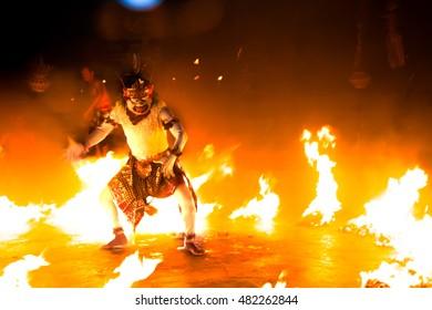 Bali, Indonesia - October 18, 2015: Traditional Balinese Kecak dance white monkey Hanuman in fire at Uluwatu Temple