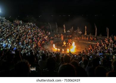 BALI, INDONESIA - OCTOBER 18, 2015- Full house, watching Kecak Fire Dance during twilight at Uluwatu Temple in Bali, Indonesia.