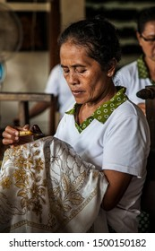 Bali, Indonesia - October, 26 2016:  Old woman from Thailand doing traditional hand craft work