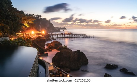 BALI, INDONESIA - SEPTEMBER, 2016 - The view from the ocean beach pool at Ayana Hotel and Spa Resort of the Kisik Bar and Grill, patrons of the hotel can have a private dinner for 2 on the platform.