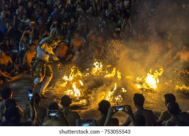 BALI, INDONESIA - SEPTEMBER 24, 2017: Traditional Balinese Kecak Dance at Uluwatu Temple. Kecak (also known as Ramayana Monkey Chant) is very popular cultural show on Bali