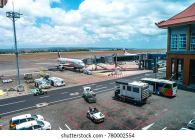 BALI, INDONESIA - SEPTEMBER 25, 2017: Plane stoping at airport on maintenance and refueling and waiting for its passengers.