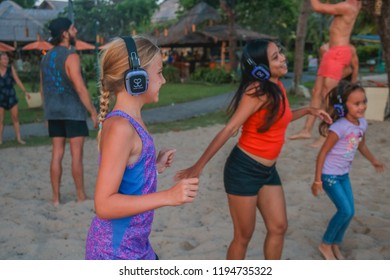 Bali, Indonesia - September 30, 2018: Young Blonde Child Smiling during Silent Disco Dance Party
