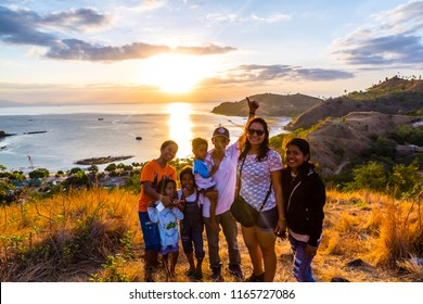 Bali, Indonesia-09.08.2018:Group of Travelers with different ethnicity on top of mountain with sunrise view, Indonesia
