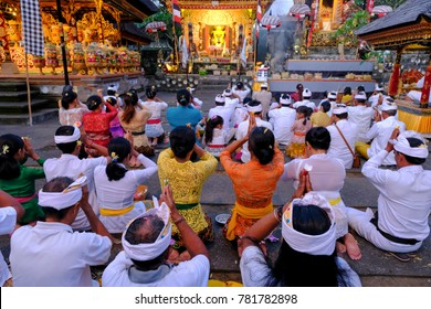 Bali, Indonesia-Dec 08, 2017:Balinese pray inside the Pura Batur Sari temple in Ubud Bali, Indonesia. Bali also known as the 'island of the gods' and has numerous religious festivals.