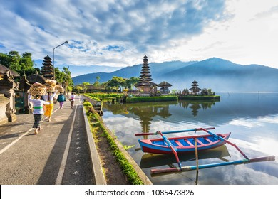 Bali, Indonesia-July 22, 2016: Unidentified local people walk to Pura Ulun Danu Bratan, Famous Hindu temple on Bratan lake in Bali, Indonesia.