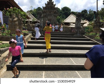 Bali, Indonesia/October 2019: Travellers enjoy the clean Panglipuran Village, Bali. Panglipuran village has become one new destination icons for travellers who visit Bali.
