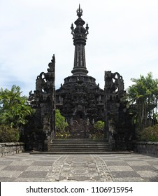 Bali Island, Indonesia - 02/25/2015: The entrance to the Bajra Sandhi in Denpasar ans bushes around construction.