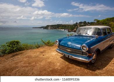 Bali island / Indonesia - 15 july 2018 - retro blue Opel car use for a tourists , Padang-Padang beach area
