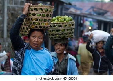 BALI - JANUARY 15: Balinese women bring out farm produce to the morning market in Kayu Ambar, Ubud January 15, 2010 in Bali, Indonesia.