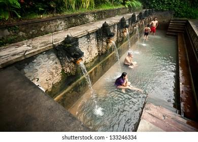 BALI - JANUARY 3 :  People take a bath in thermal Banjar Tega hot springs on jan 3, 2013, Bali, Indonesia