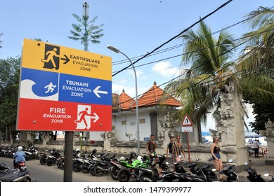 BALI - JULY 23 2019: Earthquake, Tsunami and fire evacuation warning sign. Indonesia was hit with several major earthquakes and tsunamis in 2018.