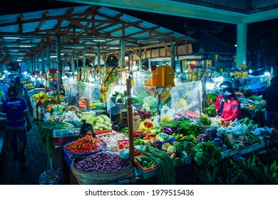 Bali, Pasar Badung -  April 26, 2021:  The night market with various goods sold to buyers during covid 19 pandemic