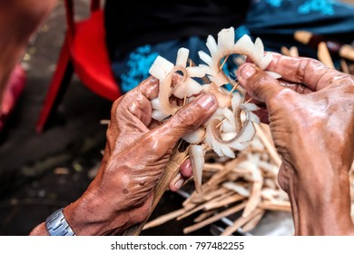 Bali people making the offering for the ceremony from the pig's skin.