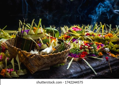 Bali sacrificial offering.Traditional Balinese religious rituals, an offering to the god. The Puja offering of flowers, water or food, left in a shrine or temple is the essential offering of Hinduism.