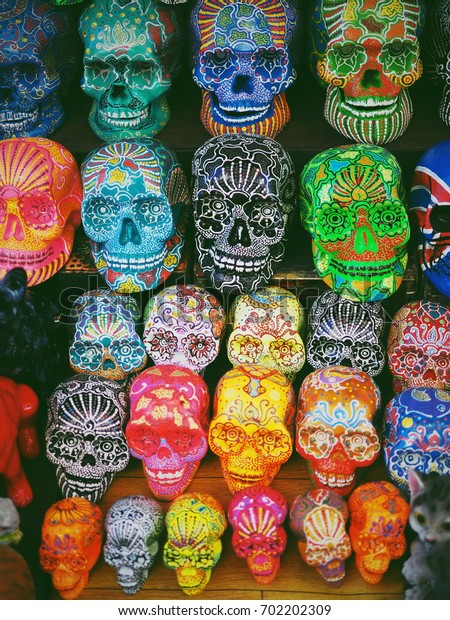 Bali souvenir, Balinese market, carved wood and colorful hand painted skull.
