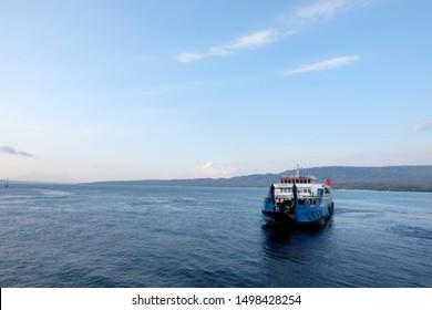 Bali Strait, Gilimanuk, Bali / Indonesia - September 6 2019 : The Ferry boat sail over Bali strait from Gilimanuk port in Bali to Ketapang port in Banyuwangi, Indonesia.