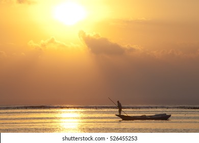 bali sunset at nusa lebongan fisherman in boat