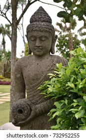 Bali or Thai Style Statue/Statue of Buddha besides plant