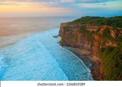 bali uluwatu beach cliff view on sunset