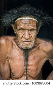 Baliem Valley, West Papua, Indonesia- November 11: Portrait of an old indigenous man from the Dugum Dani tribe located in the mountains of the Baliem Valley, West Papua, Indonesia.
