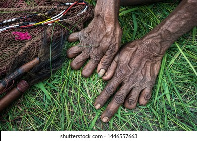 Baliem Valley, West Papua, Indonesia- November 11 2016:  Older women from the Dani tribe often cut their fingers when relatives die to show their love for them.