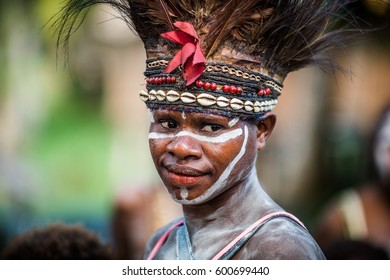 BALIEM VALLEY, WEST PAPUA, INDONESIA, MAY 14, 2016: Portrait of woman with traditional face painting and nation headdress. Dugum Dani tribe. New Guinea, Indonesia on May 14, 2016