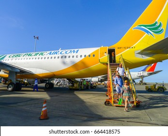 Bali/Indonesia February 24, 2016 - Tourists getting on of a Cebu Pacific Air plane
