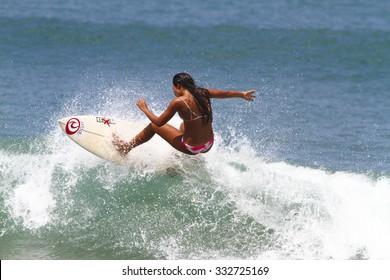 BALI,INDONESIA, OCTOBER 28, 2015; a surfer girl at Kuta beach at sunny day.