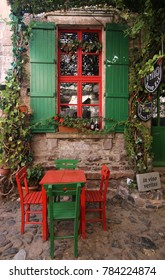 Balikesir, Cunda Island, Turkey, 10/16/2017: .Vino Vineyard House with green and red decoration, chairs and table