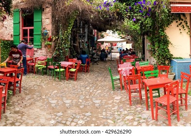 BALIKESIR, TURKEY - MAY 21 2016: open street cafe in touristic town, Cunda Alibey Island, Ayvalik.  It is a small island in the northwestern Aegean Sea, off the coast of Ayvalik in Balikesir Turkey
