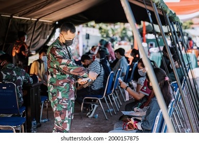 Balikpapan, Indonesia 06 26 2021 : some people in Balikpapan do the covid-19 vaccine which is facilitated by the Indonesian army