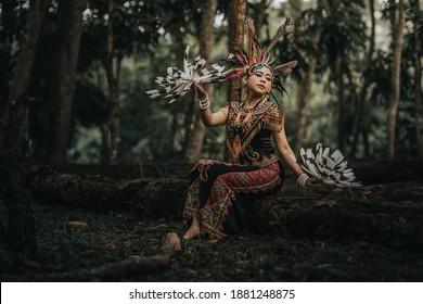 Balikpapan, Indonesia - 12-10-2020 : a portrait of a borneo dayak tribe dancer