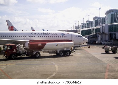 BALIKPAPAN, INDONESIA - AUGUST 02, 2017 : Pertamina Truck parked near Garuda Indonesia Boeing 737-800NG at Sultan Aji Muhammad Sulaiman Airport Sepinggan Balikpapan.