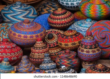 Balinese Beaded Baskets For Sale in Ubud Public Market. Colorful and creative Balinese handicrafts make great souvenirs and are featured here in the Ubud crafts market in central Bali.
